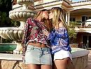 Two urban girls kiss and fuck each other near a fountain
