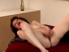 Woman Undresses And Plays With Her Pussy