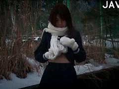 Sexy Japanese Babe Shows Off Her Tits And Panties In The Snow