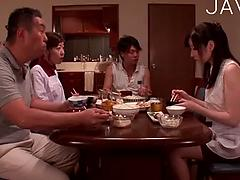 A Charming Japanese Housewife Teases In A Silky Slip