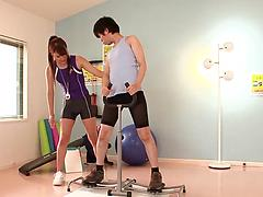 Sporty Japanese sweetie fucks with a guy in a fitness hall