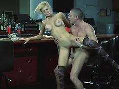 Blonde seductress with fake boobs Riley Steele fucked on the bar counter