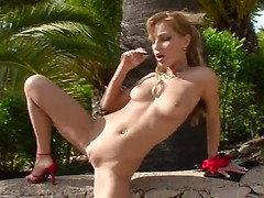 Cute girl strips and masturbates outdoors ending up with pissing