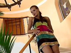 Tall skinny model in a sexy dress rubs her stretchy pussy on the stairs