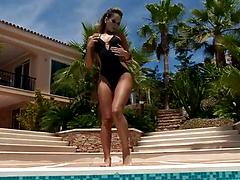 Dripping wet babe masturbates near a pool on the erotic video
